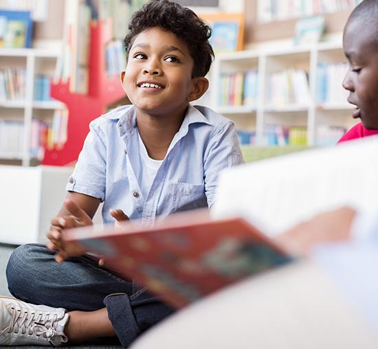 Boy with Asperger's / Autism Spectrum Disorder enjoying school classroom